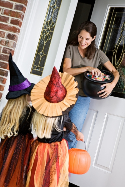 kids receiving Halloween candy while trick-or-treating